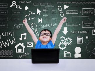a youth in front of a blackboard coding on a computer captured by GTA weekly Toronto news