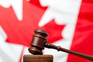 Criminal Code in front of Canadian flag for GTA weekly Toronto News