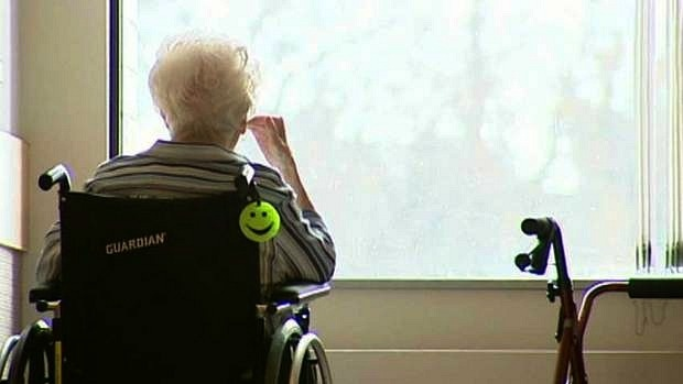 elderly patient looking outside window at long term car facility captured by GTA weekly Toronto news